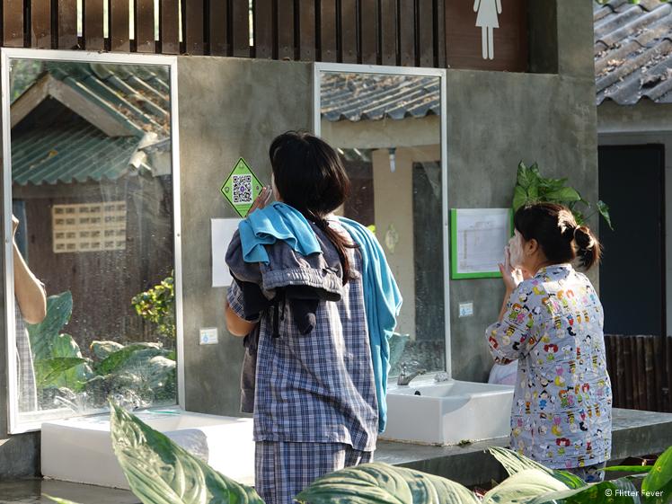 Thai women face wash at rest rooms Huay Mae Khamin Waterfalls