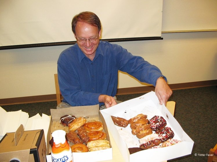 Business Law teacher treats his with donuts in class Edgewood College