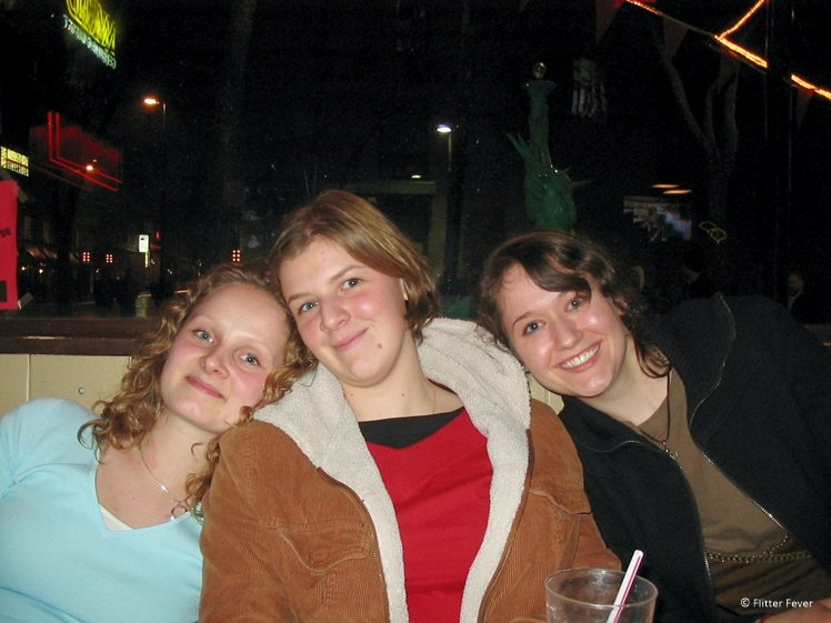 Three women hanging out together looking happy