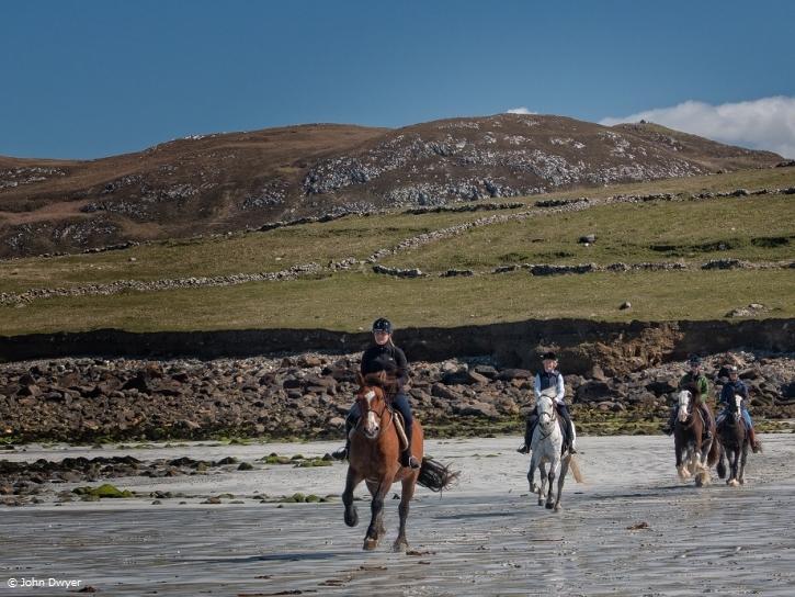 Horse riding at the beautiful coast line of Connemara Ireland