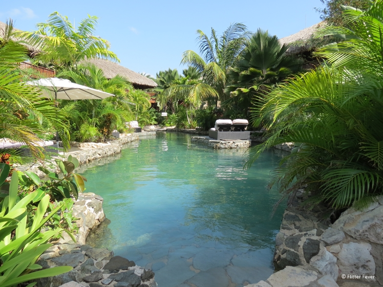 The beautiful tropical garden of Kontiki Beach Resort Curacao