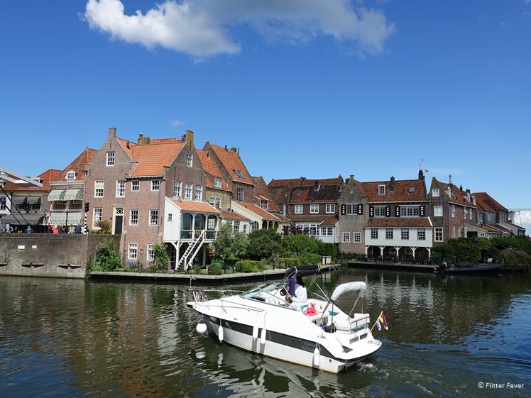 A pleasure boat sails into Enkhuizen