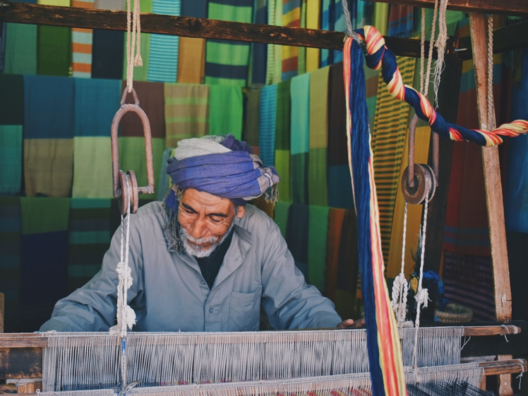 Man weaving at Aswan souk