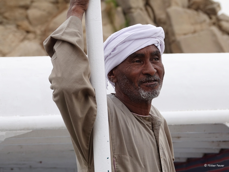 Local Nubian looking man working on a tourist boat In Aswan