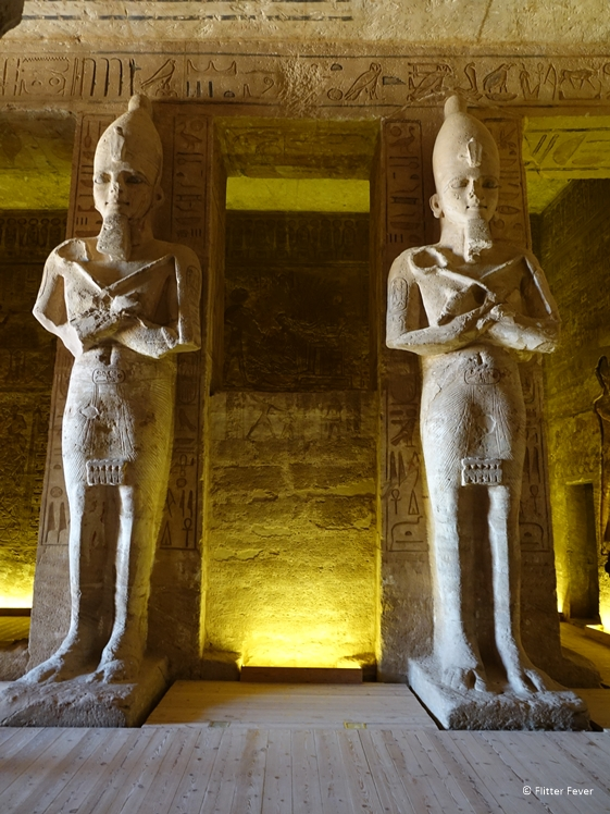 Two huge statues inside the temple of Ramses II Abu Simbel