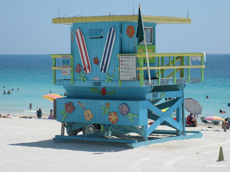 Miami South Beach blue lifeguard house with flowers and surfboards