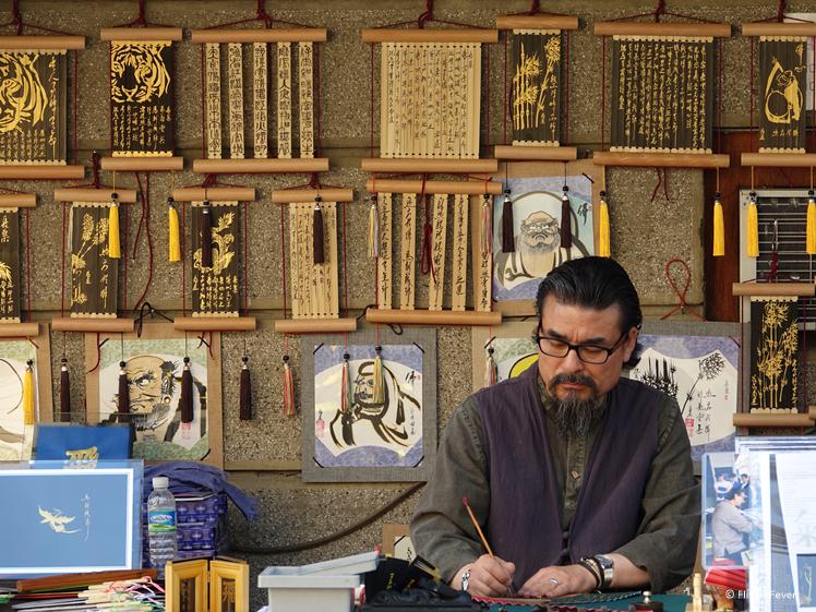 Artist at work in Bukchon Hanok Village Seoul